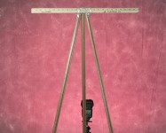 Artwork Easel and Red Gelled Background Light