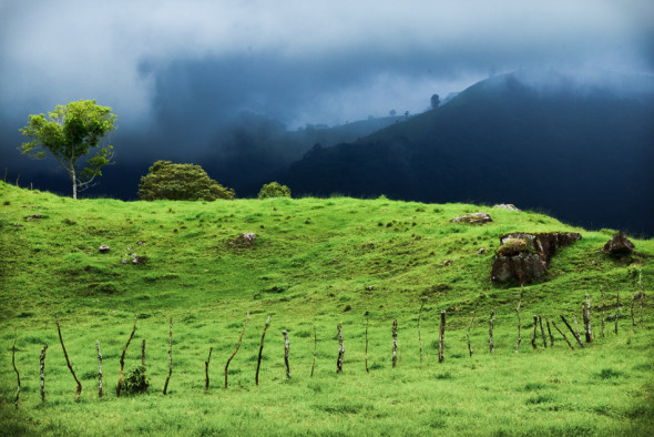 Storm Clouds Over Mountains and Cattle Pasture on Road to Volcan